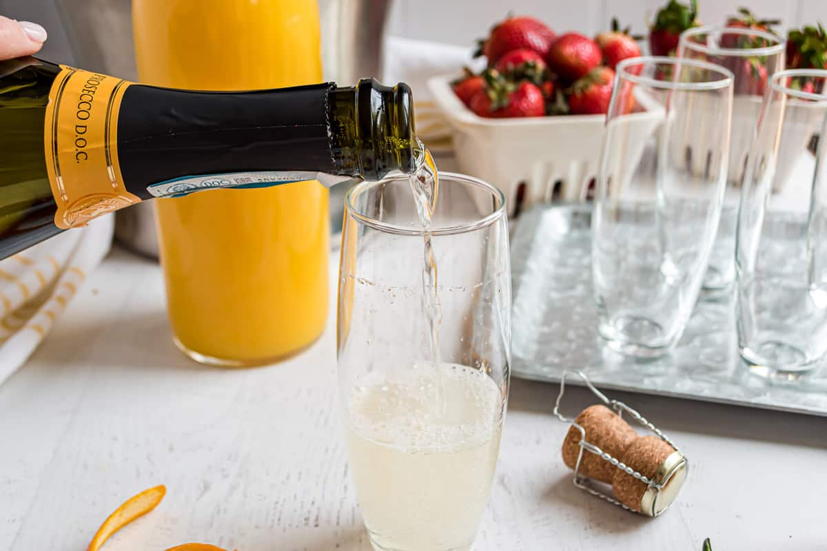 Prosecco being poured into a glass.
