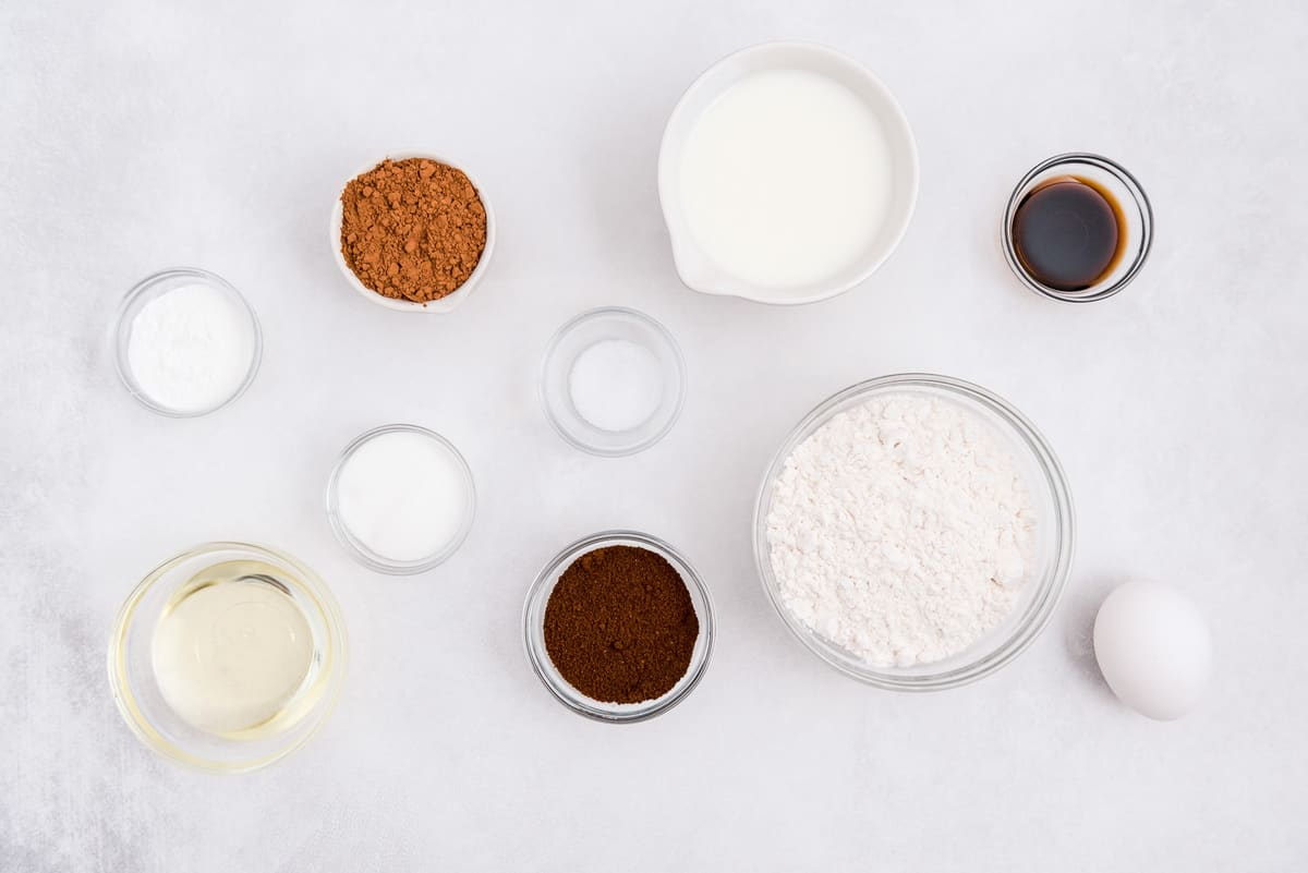 Overhead view of ingredients in small glass bowls.