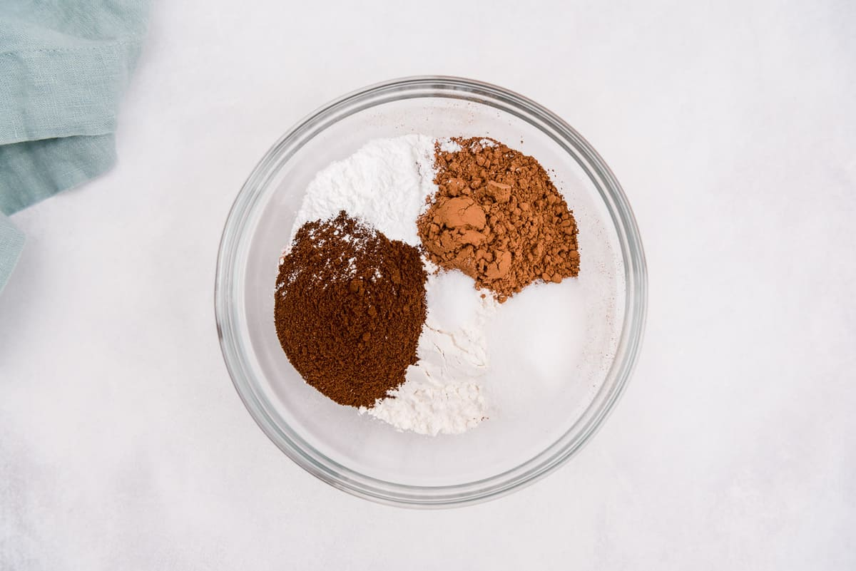 Dry ingredients in a glass mixing bowl.
