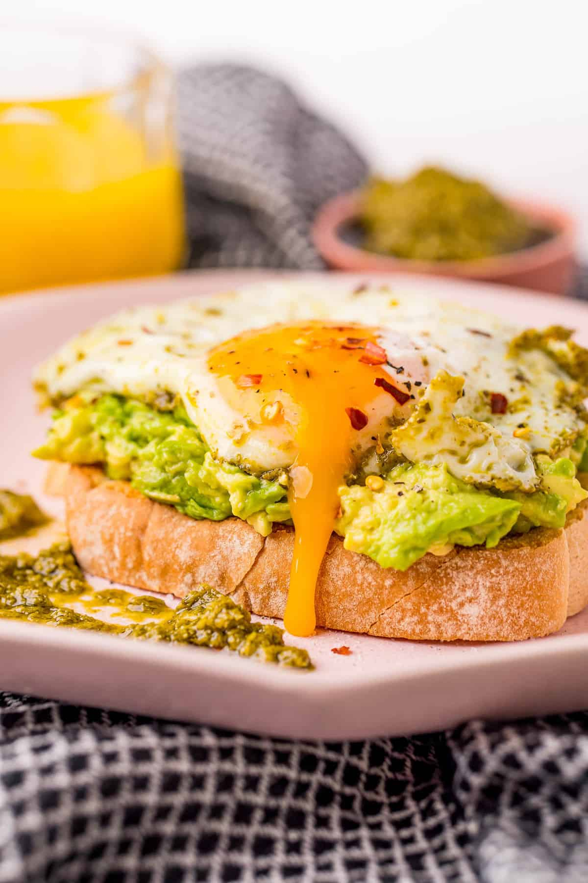 Runny egg on top of avocado toast.