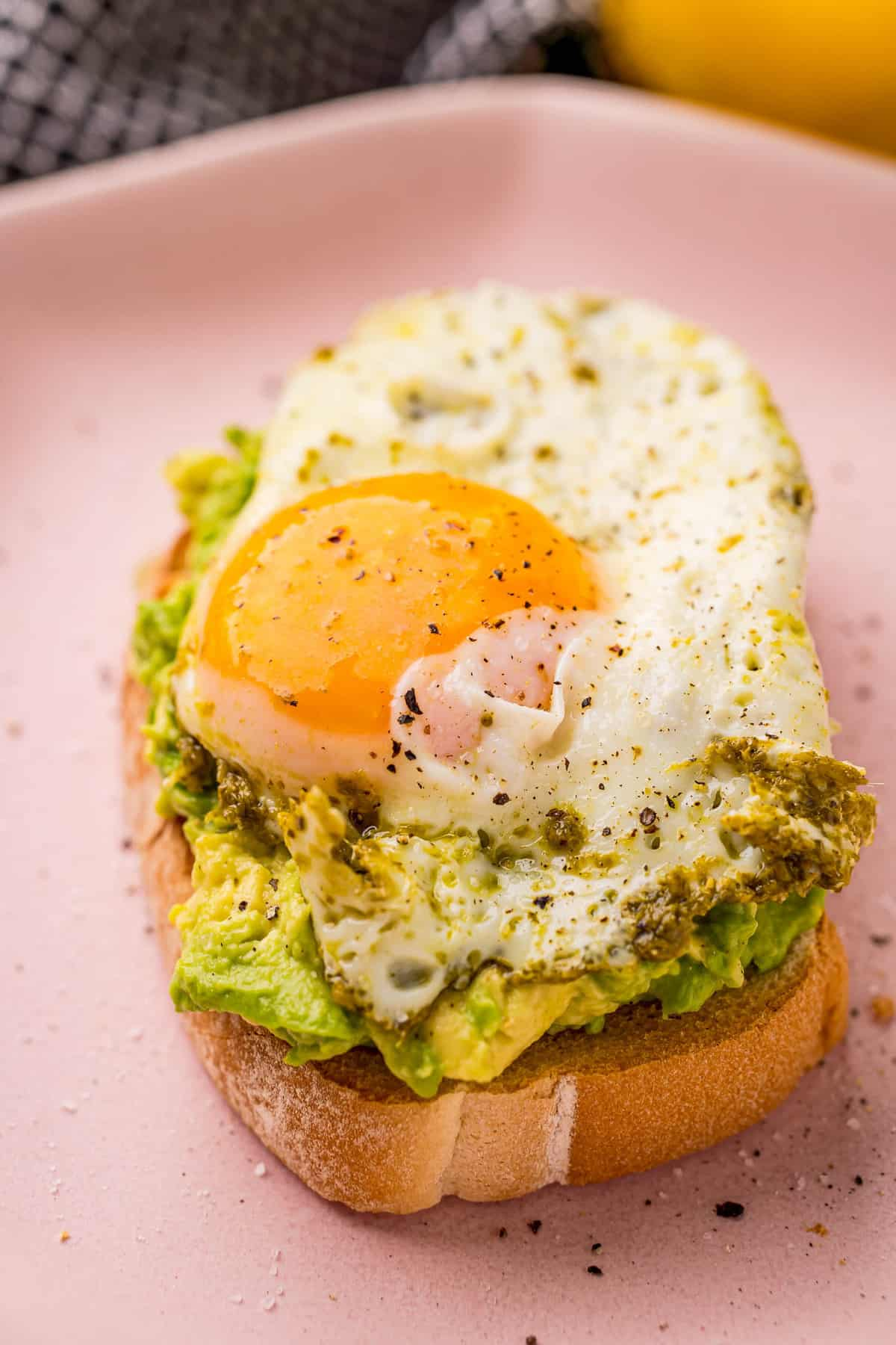 Close up of pesto egg on a plate.