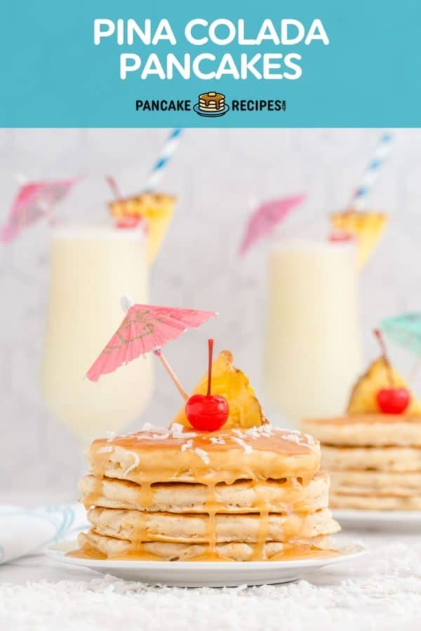 """Pancakes topped with a cherry and a paper umbrella, text overlay reads """"pina colada pancakes, pancakerecipes.com."""""""