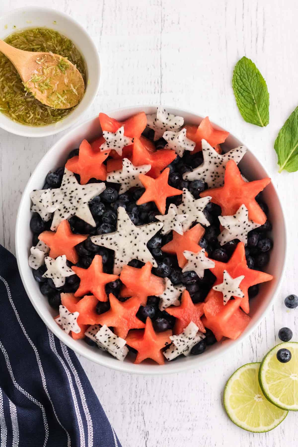 Overhead view of fruit salad with fruit cut into star shapes.