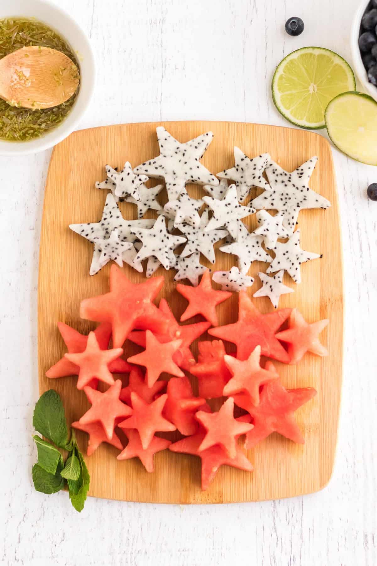 Watermelon and dragon fruit cut into star shapes.