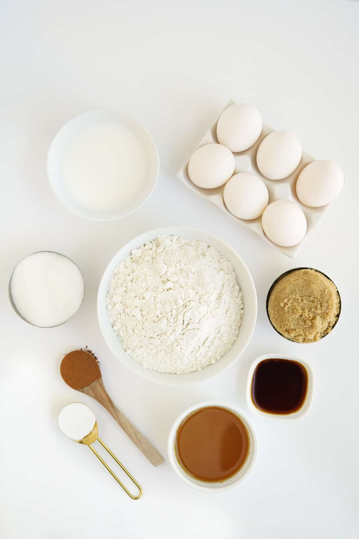 Overhead view of ingredients needed for recipe, on a white surface.