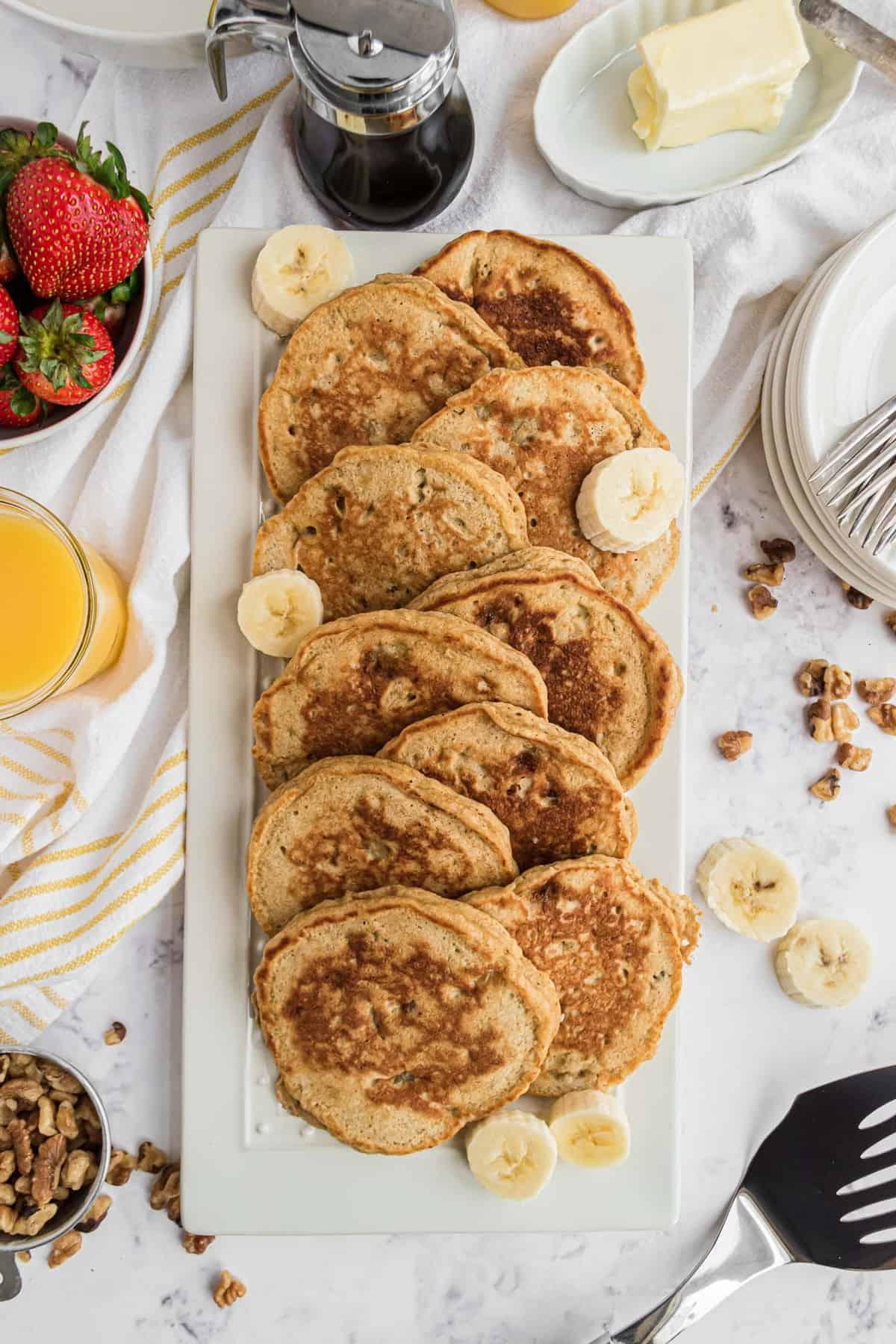 Pancakes on a large white platter.