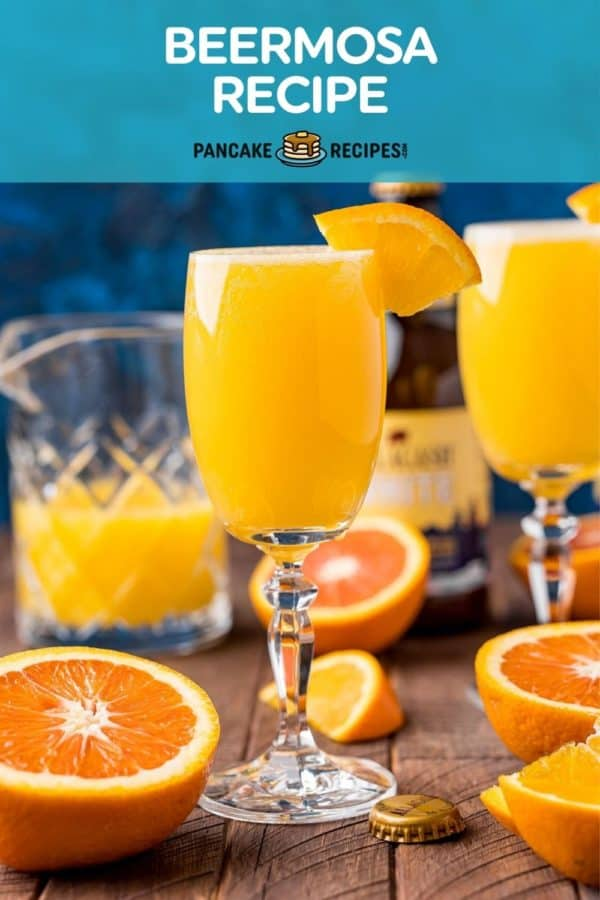 """Orange drink in stemmed glass, text overaly reads """"beermosa recipe, pancakerecipes.com."""""""