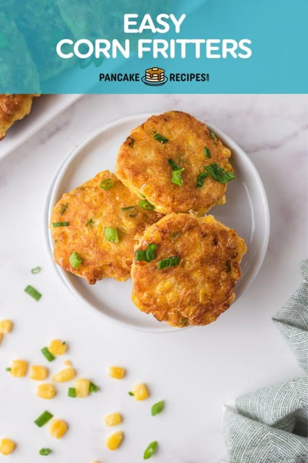 """Fritters on a white plate, text overlay reads """"easy corn fritters, pancakerecipes.com."""""""