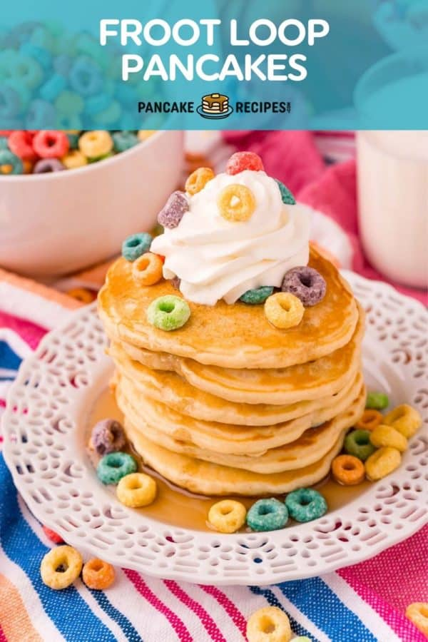 """Pancakes on a plate, text overlay reads """"froot loop pancakes."""""""