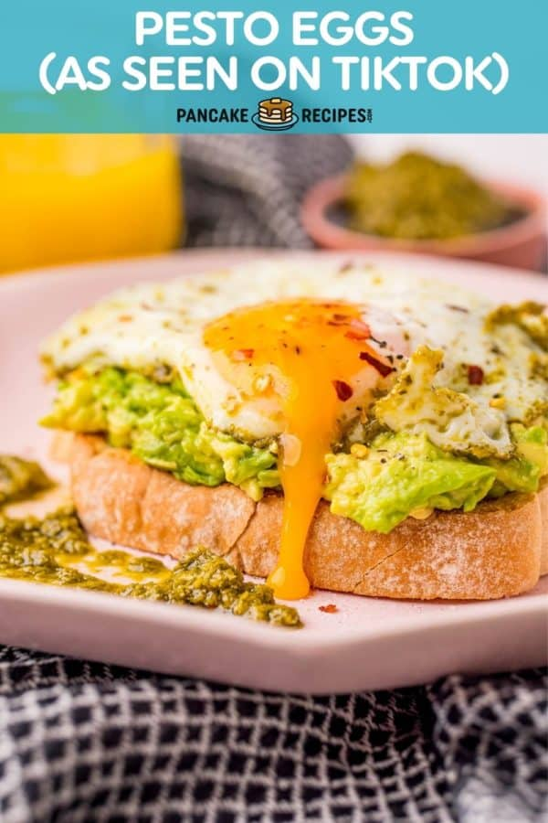 "Egg on avocado toast, text overlay reads ""pesto eggs - as seen on tiktok!"""