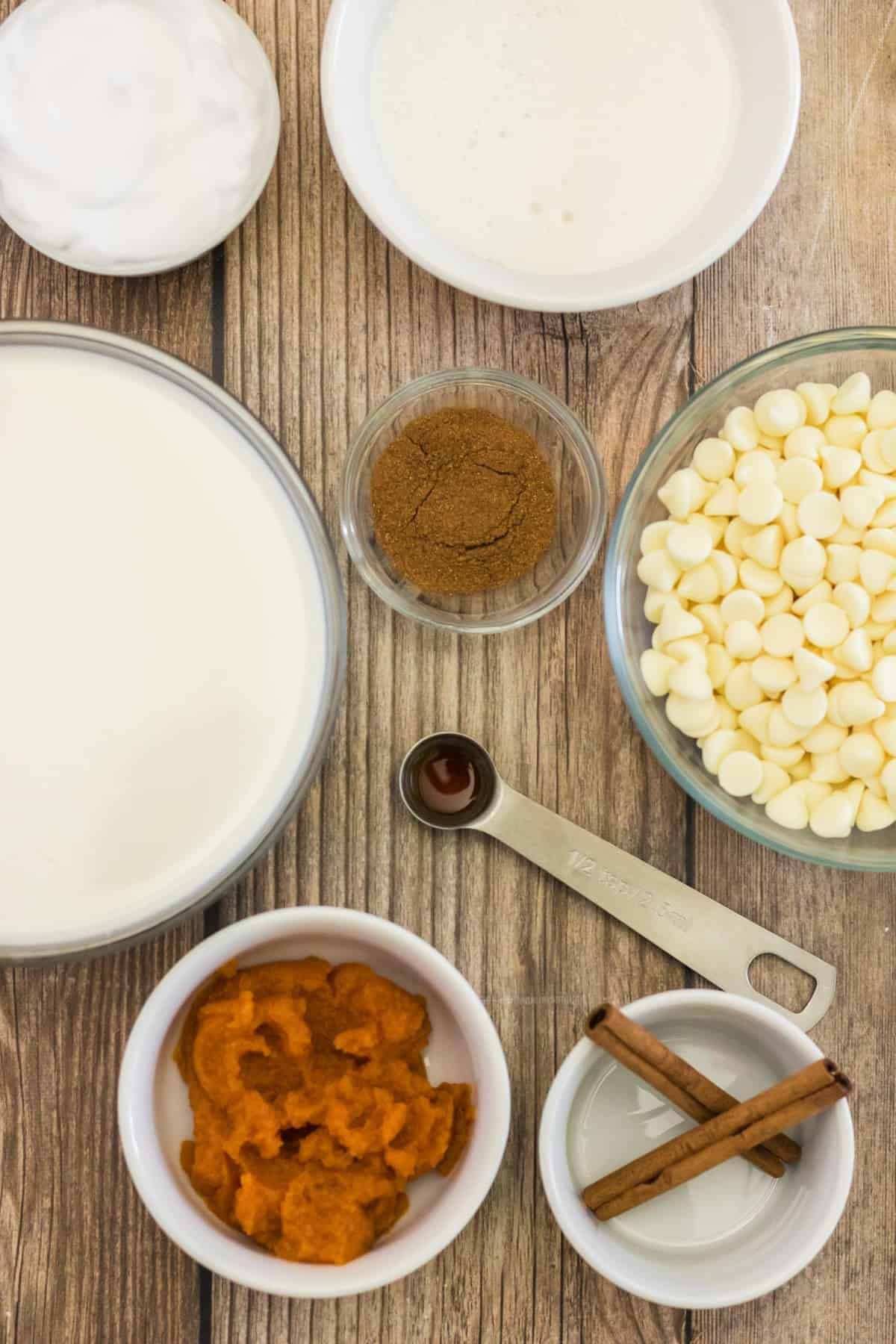 Overhead view of ingredients needed for recipe on a wooden background.