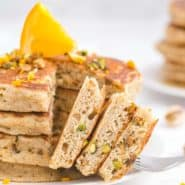 Stack of baklava pancakes with a portion cut out to show texture.
