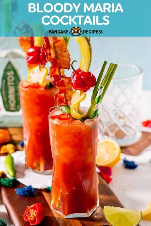 """Two heavily garnished cocktails, text overlay reads """"bloody maria cocktails, pancakerecipes.com"""""""