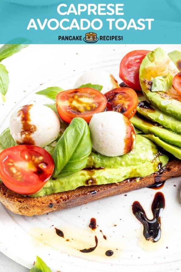 """Avocado toast with tomatoes and mozzarella, text overlay reads """"caprese avocado toast, pancakerecipes.com."""""""