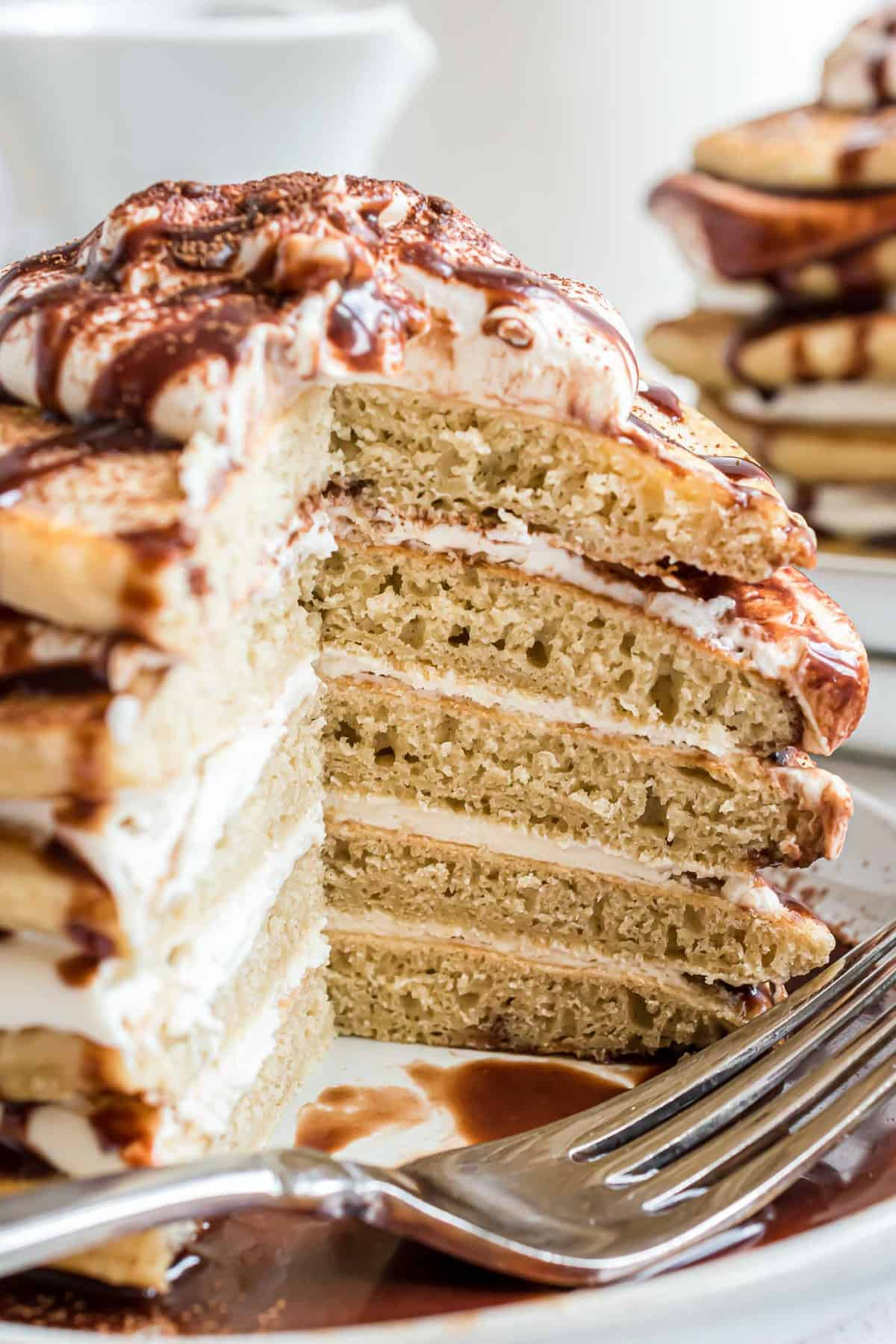 Stacked coffee pancakes cut to show mascarpone filling and