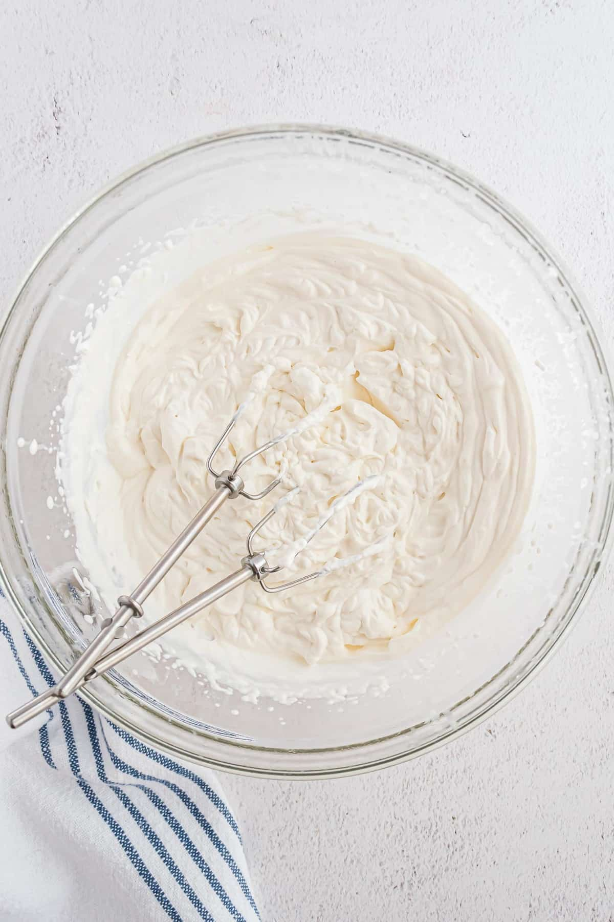 Whipped cream with beaters.