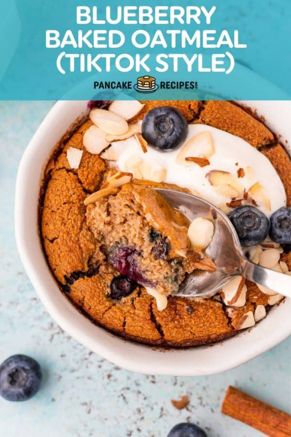 """Overhead view of small white bowl with baked oats, text overlay reads """"blueberry baked oatmeal (tiktok style)."""""""