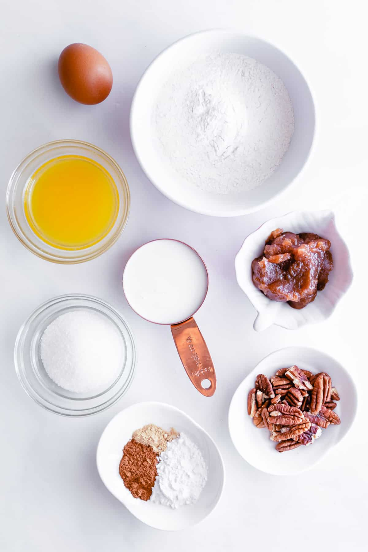 Overhead view of ingredients needed for recipe in small bowls.