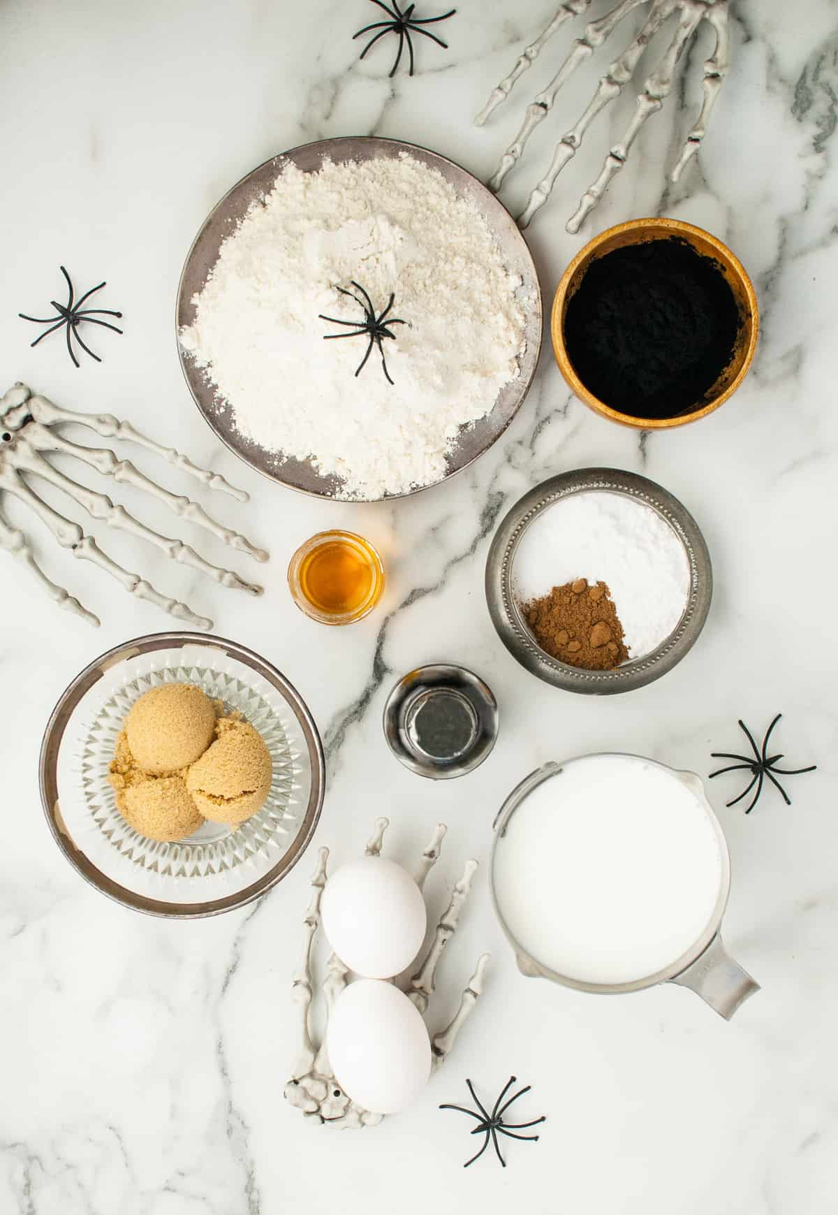 Overhead view of ingredients needed for recipe, on a marble background.