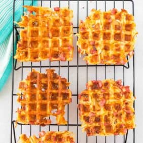 Overhead view of waffles made with hash browns, cheddar, and ham.