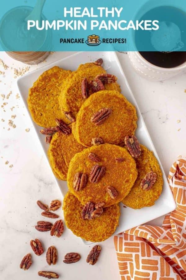 "Pancakes on a platter, text overlay reads ""healthy pumpkin pancakes."""