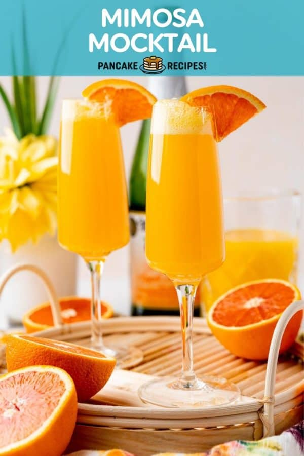 """Two orange mocktails, text overlay reads """"mimosa mocktail."""""""