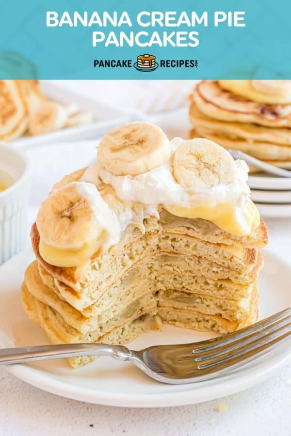 """Stack of pancakes with pudding, whipped cream, and bananas. Text overlay reads """"banana cream pie pancakes."""""""
