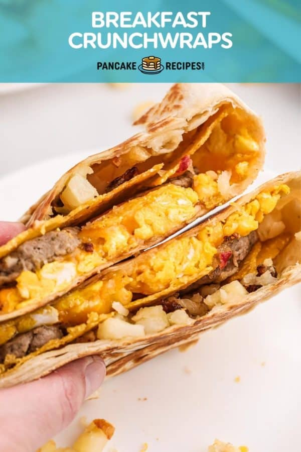 """Two halves of a crunchwrap in a hand, text overlay reads """"breakfast crunchwraps."""""""