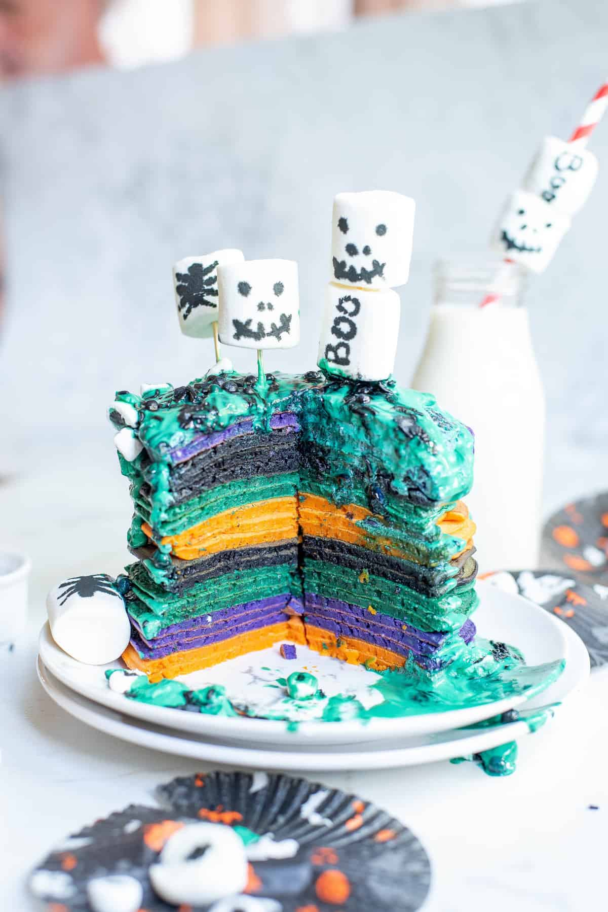 Stack of pancakes, cut to show colorful pancakes.