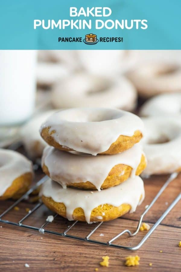 """Stack of three donuts, text overlay reads """"baked pumpkin donuts."""""""