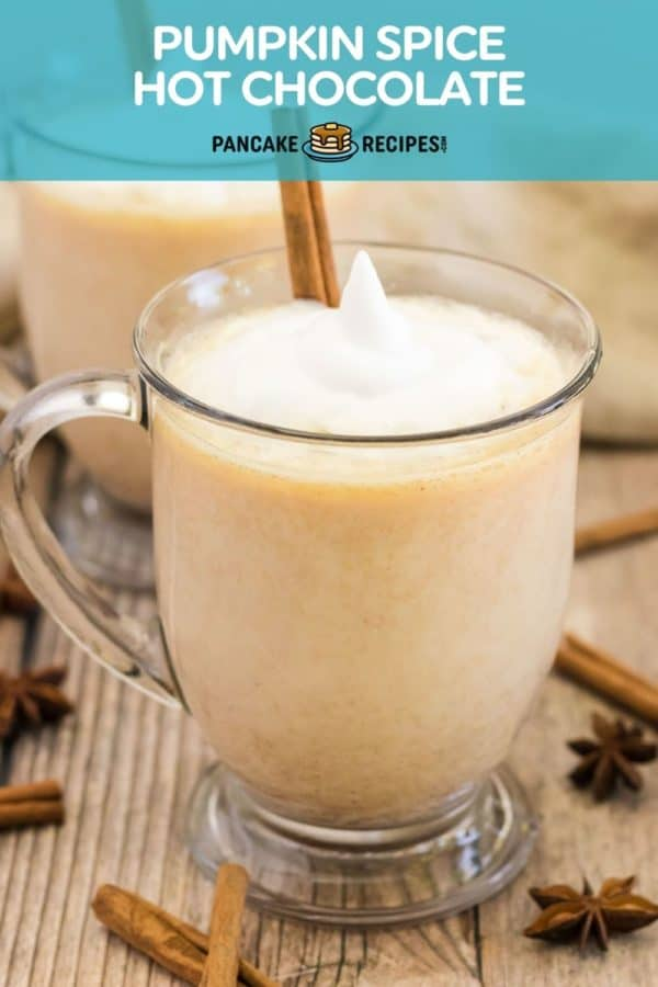 """Mug of pumpkin cocoa with whipped cream, text overlay reads """"pumpkin spice hot chocolate."""""""