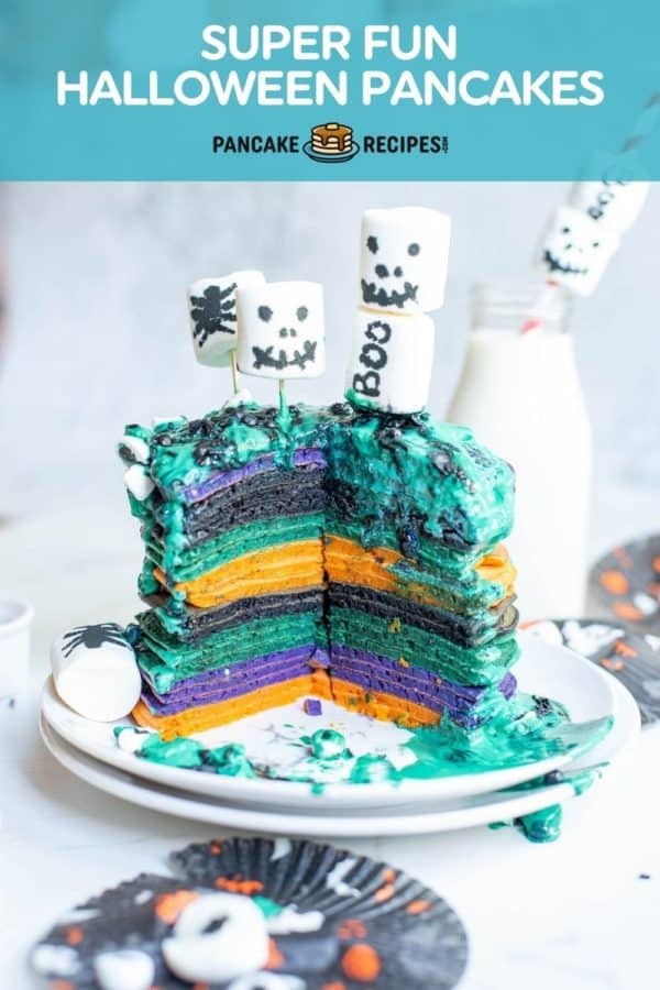 """Stack of colorful pancakes, text overlay reads """"super fun halloween pancakes."""""""
